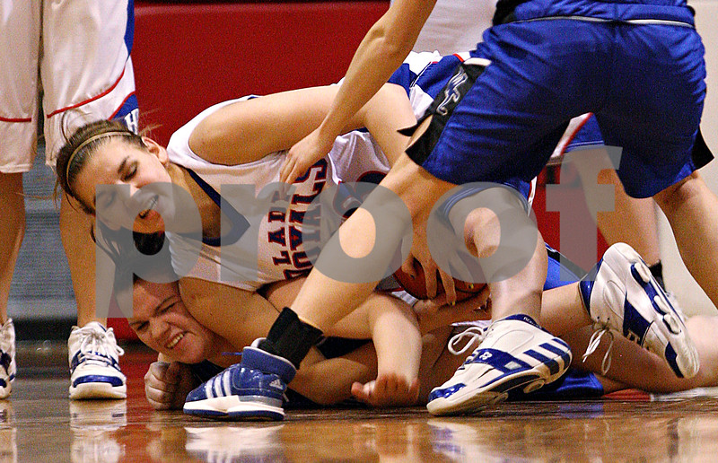 Beck Diefenbach – bdiefenbach@daily-chronicle.com<br /> <br /> Hinckley-Big Rock's Tess Godhardt (top) tears the ball away from Westminster's Emily Brickford (23) during the fourth quarter of the IHSA Class 1A Regional playoff game at Indian Creek High School in Shabbona, Ill., on Wednesday Feb. 10, 2010.