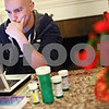 Beck Diefenbach – bdiefenbach@daily-chornicle.com<br /> <br /> Medications flank his laptop as Kevin Ballantine, 20, works on his chemistry home work at his home in DeKalb, Ill., on March 11, 2009. Although diagnosed with Leukemia, Ballantine is still attending classes at Northern Illinois University to keep his student health insurance.