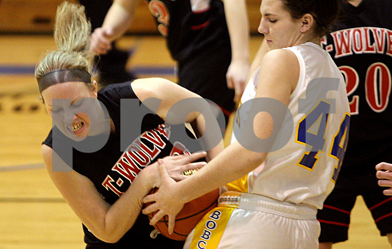 Rob Winner – rwinner@daily-chronicle.com<br /> Indian Creek's Vicki Novotny (left) and Somonauk's Karrah Kuykendall try to control a ball during the first quarter of their game at the Little 10 tournament in Hinckley, Ill. on Monday January 18, 2010.