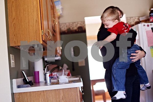 Beck Diefenbach  -  bdiefenbach@daily-chronicle.com<br /> <br /> Tyler Neppel, 4, hugs hs mother Heather, at their Sycamore home on Friday March 5, 2010. Tyler is living with Neurofibromatosis which causes tumors to grow around his eye and his shin.