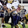 Rob Winner – rwinner@daily-chronicle.com<br /> <br /> Sterling quarterback Alejandro Rivera carries the ball in the first quarter in DeKalb, Ill. on Friday September 17, 2010.