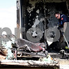 Beck Diefenbach  -  bdiefenbach@daily-chronicle.com<br /> <br /> DeKalb firefighter Tom Conley shovels burned debris following a demonstration by the DeKalb Fire Department in support of residential sprinkler systems at DeKalb Taylor Municipal Airport in DeKalb, Ill., on Monday May 3, 2010. Another room equipped with a sprinkler system was also ignited and extinguished with its own sprinkler system.