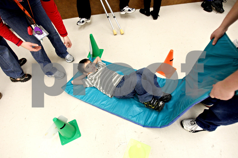 Rob Winner – rwinner@daily-chronicle.com<br /> Michael Vance, 7, lies down on a mat to simulate a luge at Camelot School in DeKalb, Ill. on Friday February 26, 2010. The students at Camelot have spent the last two weeks learning all about the winter olympics.