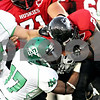 Rob Winner – rwinner@daily-chronicle.com<br /> <br /> North Dakota defensive back Chavon Mackey (17) tries to wrestle a ball away from Northern Illinois running back Chad Spann during the second quarter in DeKalb, Ill. on Saturday September 11, 2010.