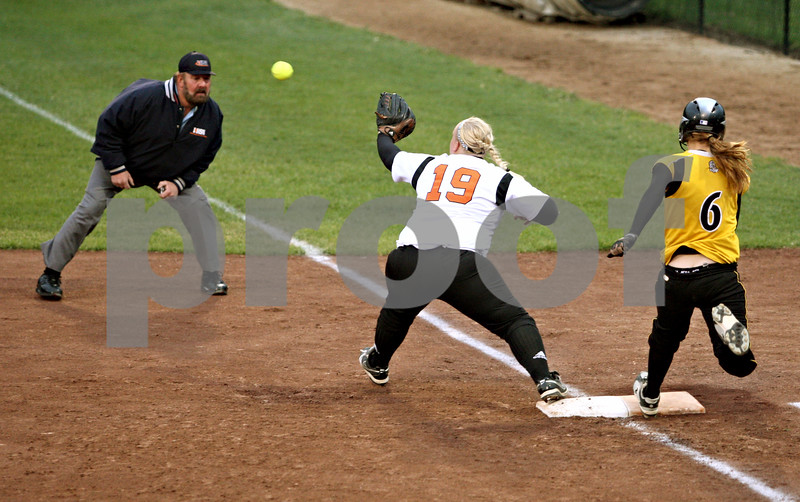 Rob Winner – rwinner@daily-chronicle.com<br /> <br /> Sycamore's Ashley Colen (6) beats out a throw from right field for a hit in the third inning.