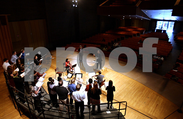 Beck Diefenbach  -  bdiefenbach@daily-chronicle.com<br /> <br /> Northern Illinois University's chamber choir rehearses with Dr. Eric Johnson and the famous American composer Morten Lauridsen looks on during an open rehearsal in the Boutell Memorial Concert Hall in the Music Building on the NIU campus in DeKalb, Ill., on Tuesday Feb. 16, 2010.