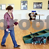 Rob Winner – rwinner@daily-chronicle.com<br /> <br /> Sam Lenser walks a cat on a leash and harness during a cat training demonstration at TAILS Humane Society in DeKalb, Ill. on Saturday August 7, 2010.