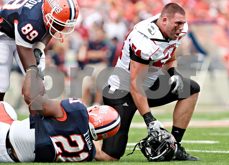 Rob Winner – rwinner@daily-chronicle.com<br /> <br /> Northern Illinois linebacker Jake Coffman picks up his helmet after stopping Illinois running back Jason Ford during the first half of their game in Champaign, Ill.  on Saturday September 18, 2010.