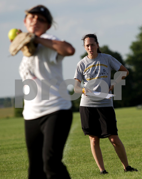 Beck Diefenbach  -  bdiefenbach@daily-chronicle.com<br /> <br /> Coach Jill Carpenter (right) watches during tryouts for a new 14U travel fastpitch softball team for called Sycamore Flash, at the Sycamore High School softball field in Sycamore, Ill., on Wednesday July 28, 2010.