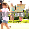 Beck Diefenbach - bdiefenbach@daily-chronicle.com<br /> <br /> (From left) Destiny Bons, of Sycamore, Dean Wickstrom, of DeKalb, and Sara Brown, of DeKalb, protest outside the entrance to the Carson and Barnes Circus at the Sycamore Speedway in Sycamore, Ill., on Monday August 9, 2010.