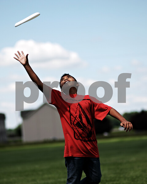 Beck Diefenbach  -  bdiefenbach@daily-chronicle.com<br /> <br /> Benji Renteria reaches to catche a frisbee during an outdoor education portion of Spartan Reach summer program at Sycamore High School in Sycamore, Ill., on Wednesday June 30, 2010.