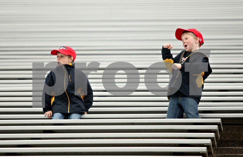 Rob Winner – rwinner@daily-chronicle.com<br /> <br /> Two young fans watch Northern's final spring football practice from the stands in DeKalb, Ill. on Saturday April 24, 2010.
