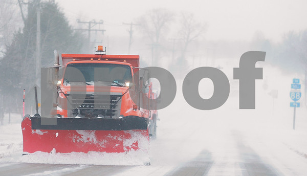 Kyle Bursaw – kbursaw@daily-chronicle.com<br /> <br /> A plow clears snow off of First street near highway 88 in DeKalb, Ill. on Sunday, Dec. 12, 2010.
