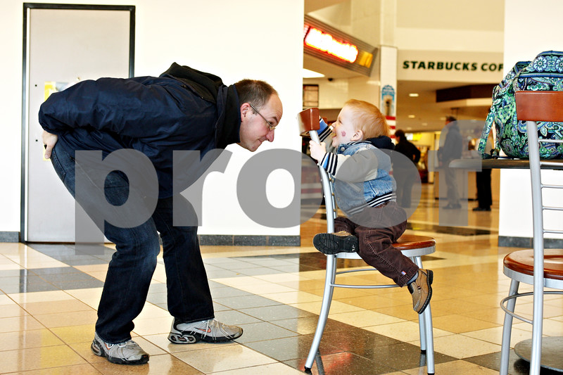 Rob Winner – rwinner@daily-chronicle.com<br /> <br /> Jerry Jameson plays with his 1-year-old son, Elijah, after a lunch break at the DeKalb Oasis on Tuesday afternoon. The Jameson family is traveling to Mount Morris from Roanoke, Va. to visit Jerry's parents for Thanksgiving.
