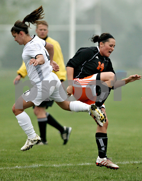 Rob Winner – rwinner@daily-chronicle.com<br /> <br /> Sycamore's Emma Norris (left) and DeKalb's Jennifer Dorland collide during the first half of their game at Barbfest on Saturday April 24, 2010 in DeKalb, Ill.