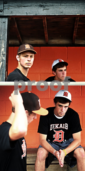 Beck Diefenbach  -  bdiefenbach@daily-chronicle.com<br /> <br /> Following a collision during the state semi-final game, DeKalb High School baseball players Jake Gordon, left, and Brian Sisler are past recovery and are back on the field.