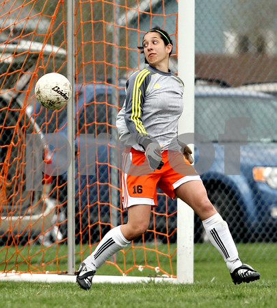 Beck Diefenbach  -  bdiefenbach@daily-chronicle.com<br /> <br /> DeKalb goal keeper Rachel Torres watches as the ball nearly goes into the goal during the second half of the game at DeKalb High School in DeKalb, Ill., on Monday April 12, 2010. Plainfield North defeated Dekalb 4 to 1.