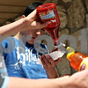 Beck Diefenbach  -  bdiefenbach@daily-chronicle.com<br /> <br /> Genoa-Kingston High School student Roberto Pavra gets his free hot dogs from the Patriots Hot Dog stand in Malta, Ill., on Monday April 26, 2010. Pavra was among many students in the building trades class which received free hot dogs for completing the construction of the new Malta police department.