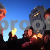 Beck Diefenbach  -  bdiefenbach@daily-chronicle.com<br /> <br /> From left, Northern Illinois junior Jessica Collinsgrove, senior Katie Brudd and junior Susan Mitchell light each other's candles before the start of the candlelight vigil at the Martin Luther King Commons on the campus of NIU in DeKalb, Ill., on Sunday Feb. 14, 2010.