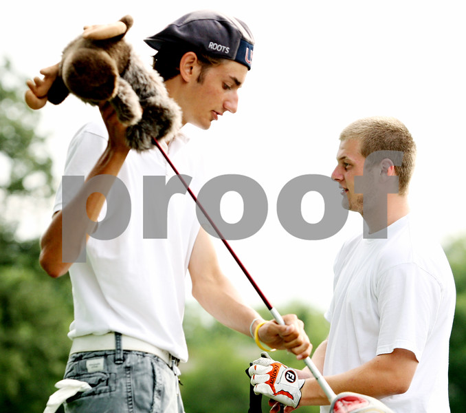 Rob Winner – rwinner@daily-chronicle.com<br /> <br /> Mason Struthers (left) and Cody Schmitt, of the DeKalb golf team, talk during practice at the Buena Vista Golf Course in DeKalb, Ill on Tuesday August 17, 2010.