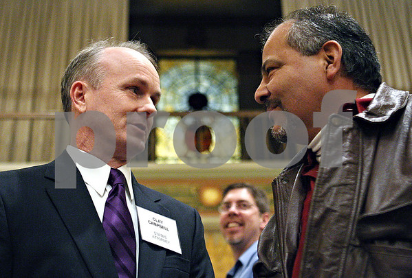 Rob Winner – rwinner@daily-chronicle.com<br /> States attorney candidate Clay Campbell (left) speaks with Armando Alamia for a meet and greet during the DeKalb Chamber of Commerce's Candidates' Night at the Egyptian Theatre in DeKalb, Ill. on Tuesday January 19, 2010.