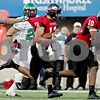 Rob Winner – rwinner@daily-chronicle.com<br /> <br /> Northern Illinois quarterback Chandler Harnish is grabbed by the jersey during a run to start out the second quarter in DeKalb, Ill. on Saturday September 11, 2010. Northern Illinois went on to defeat North Dakota, 23-17.
