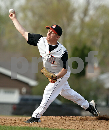 Beck Diefenbach  -  bdiefenbach@daily-chronicle.com<br /> <br /> DeKalb pitcher Jake Lemay (1) winds up during the second inning of the game against Batavia at DeKalb High School in DeKalb, Ill., on Thursday April 15, 2010. Batavia defeated DeKalb 7 to 4.