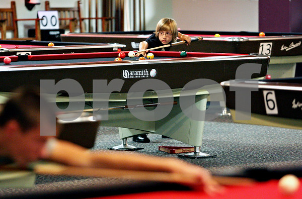 Rob Winner – rwinner@daily-chronicle.com<br /> <br /> Brady Paananen, 11 of Hazel Park, Michigan, lines up his shot while participating in the 22nd Annual Junior National 9-Ball Championships at Northern Illinois University in DeKalb, Ill. on Thursday July 8, 2010.