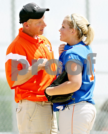 Rob Winner – rwinner@daily-chornicle.com<br /> <br /> Genoa-Kingston assistant coach Scott Miller talks with pitcher Karli Beauchamp at the end of the fifth inning during the IHSA Class 2A Byron Regional final against Stillman Valley in Byron, Ill. on Saturday May 22, 2010. Stillman Valley went on to defeat Genoa-Kingston, 5-2, ending their season.