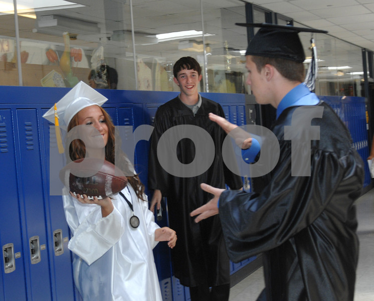 Kaneland graduates Megan Gil, left, 17, Tyler Hamer, 17, and Bobby Langeness, 18, toss a football around in the hallway before their commencement ceremony on Sunday, May 30, 2010 in Maple Park, Ill. (Marcelle Bright/for the Chronicle)