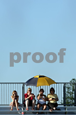 Beck Diefenbach  -  bdiefenbach@daily-chronicle.com<br /> <br /> Sporting a yellow and black umbrella, fans make use of the temporary outfield bleachers during the sixth inning of the IHSA Class 2A Regional semi final game between DeKalb and Sycamore at Sycamore High School in Sycamore, Ill., on May 27, 2010.