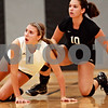Beck Diefenbach – bdiefenbach@daily-chronicle.com<br /> <br /> Kaneland's Kylie Siebert (1, left) and Melanie Thompson (10) watch as Sycamore increases their lead during the second game at Kaneland High School in Maple Park, Ill., on Tuesday Sept. 21, 2010.