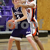 Beck Diefenbach  -  bdiefenbach@daily-chronicle.com<br /> <br /> DeKalb's Michelle Todd (3, right) blocks the view of Rochelle's Olivia Caron (5) during the second quarter of the IHSA Class 3A Regional game at Rochelle Township High School in Rochelle, Ill., on Wednesday Feb. 17, 2010