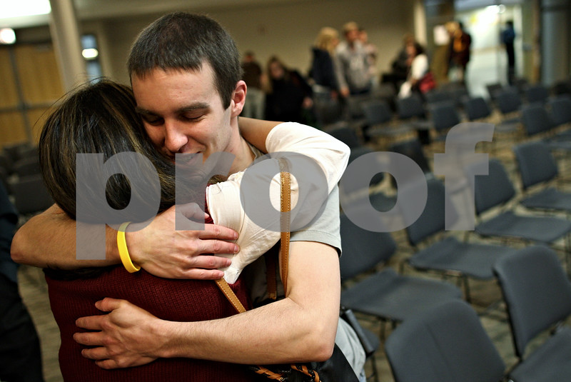 Beck Diefenbach – bdiefenbach@daily-chornicle.com<br /> <br /> Kevin hugs a friend following a lecture at  Northern Illinois University titled Life's Top Ten List, a culmination of life lessons he has learned through his ordeal, on Nov. 4, 2009.