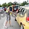 Rob  Winner – rwinner@daily-chronicle.com<br /> <br /> DeKalb firefighter Noah Millard uses a boot to collect donations for the Muscular Dystrophy Association from drivers at the intersection of First Street and Hillcrest Drive in DeKalb, Ill. on Friday September 3, 2010.