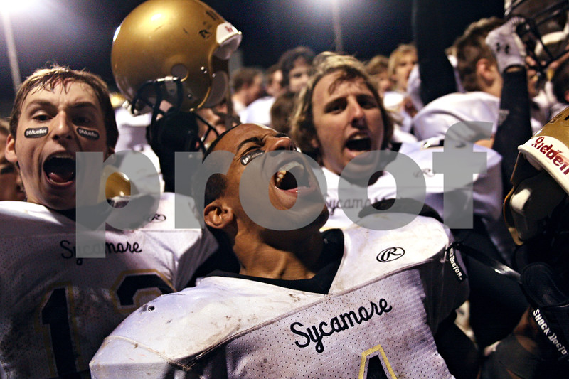 Beck Diefenbach  -  bdiefenbach@daily-chronicle.com<br /> <br /> Sycamore running back Marckie Hayes (1, center) and quarterback Trevor Mathey (12, left) react after defeating Kaneland in the class 5A playoff game at Kaneland High School in Maple Park, Ill., on Saturday Oct. 31, 2009.