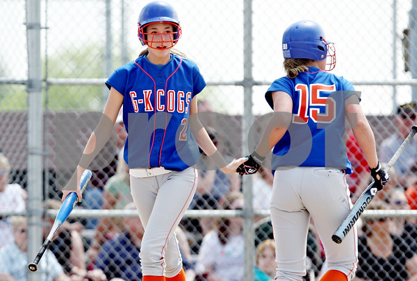 Rob Winner – rwinner@daily-chronicle.com<br /> <br /> Kelsie Campbell (left) is greeted by teammate Jordan Rich after scoring Genoa-Kingston's first run in the first inning during the IHSA Class 2A Byron Regional final against Stillman Valley in Byron, Ill. on Saturday May 22, 2010. Stillman Valley went on to defeat Genoa-Kingston, 5-2, ending their season.