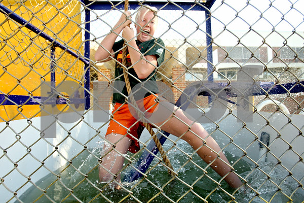 Rob Winner – rwinner@daily-chronicle.com<br /> <br /> DeKalb resident Elayne Young (sp), 13, tests out the dunk tank before the start of September Fest at St. Mary's School in Dekalb, Ill. on Friday September 24, 2010.