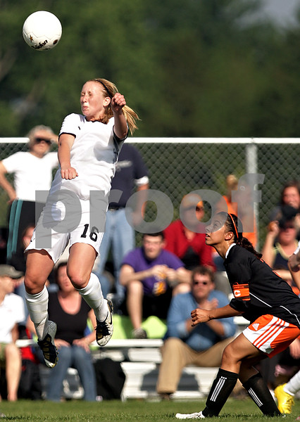 Beck Diefenbach  -  bdiefenbach@daily-chronicle.com<br /> <br /> Sycamore's Lindsey Hemmerich (16, left) leaps to head the ball above DeKalb's Jassmine Marquez (3) during the second half of the IHSA Class 2A Rochelle Regional Championship at Rochelle Township High School in Rochelle, Ill., on Friday May 21, 2010. Sycamore defeated DeKalb 2 to 1.