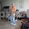 Beck Diefenbach – bdiefenbach@daily-chornicle.com<br /> <br /> Kevin (center) and his family laugh has he plays on the Wii Fit at their temporary apartment in Chicago, Ill., on July 18, 2009.