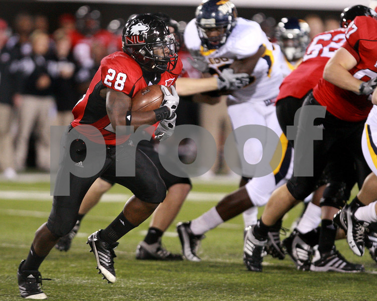 Kyle Bursaw — kbursaw@daily-chronicle.com<br /> <br /> Northern Illinois running back Chad Spann (28) looks for some room upfield during the game against the Toledo in in DeKalb, Ill. on Nov. 9, 2010.