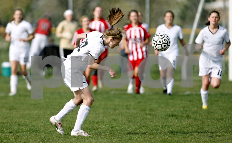 Rob Winner – rwinner@daily-chronicle.com<br /> <br /> Lauren Miller uses her head to move the ball during a home game in Sycamore, Ill. against Batavia on Thursday April 22, 2010.