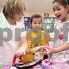 Kyle Bursaw – kbursaw@daily-chronicle.com<br /> <br /> Second-graders, from left, Lauren Smid, Lillyanna Celestino and Tenasia Adams react to some of the gifts they find at the holiday shoppe at West Elementary in Sycamore on Tuesday, Dec. 21, 2010. The holiday shoppe gave students an opportunity to buy gifts for $1 each.