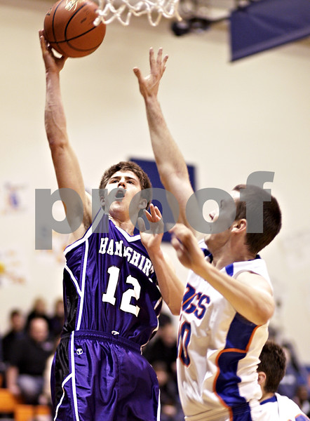 Beck Diefenbach  -  bdiefenbach@daily-chronicle.com<br /> <br /> Hampshire's Justin Bieber (12, left) shoots the ball above Genoa-Kingston's Ethan Menges (10) during the second quarter of the game at Genoa-Kingston High School in Genoa, Ill., on Monday Jan. 11, 2009. Hampshire defeated G-K 57 to 52.