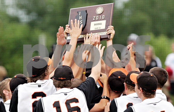 Rob Winner – rwinner@daily-chronicle.com<br /> <br /> The DeKalb baseball team hoists up their IHSA Class 3A Augustana College Super-Sectional trophy on Monday June 7, 2010. DeKalb defeated Galesburg, 8-4.