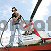 Rob Winner – rwinner@daily-chronicle.com<br /> <br /> Mitchell Hendrickson, of Hendrickson Flying Service located in Rochelle, finishes refilling a crop dusting helicopter with fuel near Fenstermaker and Barber Greene roads in Cortland Township on Friday July 23, 2010.