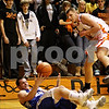Beck Diefenbach  -  bdiefenbach@daily-chronicle.com<br /> <br /> DeKalb's Jordan Threloff (42, right) throws the ball at Geneva's Michael Santacaterina (20) to force it out of bounds during the third quarter of the game at DeKalb High School, in DeKalb, Ill., on Friday Jan. 5, 2010. DeKalb defeated Geneva 55 to 52.
