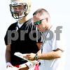 Rob Winner – rwinner@daily-chronicle.com<br /> <br /> Quarterback Ryan Bartels (left) talks to Spartans coach Joe Ryan during the first practice on Wednesday August 11, 2010 in Sycamore, Ill.