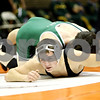 Rob Winner – rwinner@daily-chronicle.com<br /> <br /> Glenbard West's Will Stano (top) holds down DeKalb's Robbie Miller during their 152-pound quarterfinal match at the Don Flavin Tournament at DeKalb on Wednesday, Dec. 29, 2010.<br /> <br /> **Stano of GW won