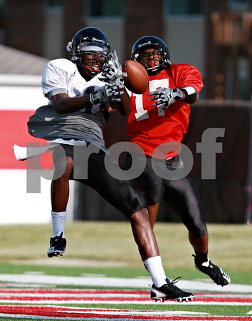 Beck Diefenbach  -  bdiefenbach@daily-chronicle.com<br /> <br /> Northern Illinois University's Martel Moore, left, and Marckie Hayes during practice at Huskie Stadium in DeKalb, Ill., on Wednesday Aug. 25, 2010.